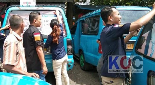 Bawaslu Kotamobagu Copot APK Terpasang di Angkot